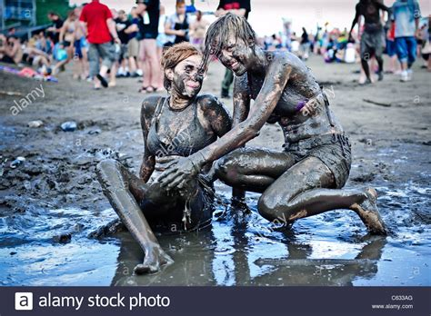 Young women having fun in the mud at the Przystanek